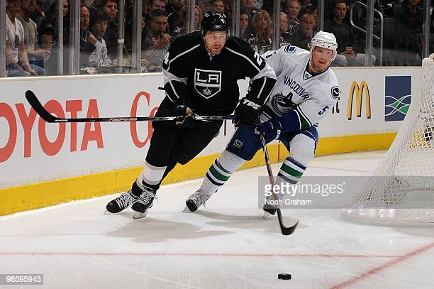 Alexander Frolov of the Los Angeles Kings battles for the puck against Shane O'Brien of the Vancouver Canucks in Game Three of the Western Conference...