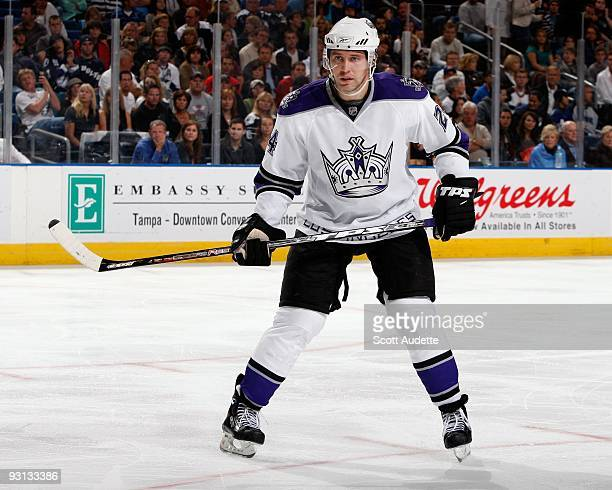 Alexander Frolov of the Los Angeles Kings defends the zone against the Tampa Bay Lightning at the St Pete Times Forum on November 14 2009 in Tampa...