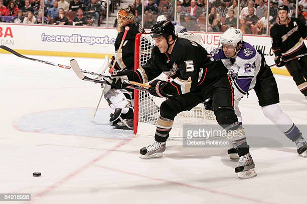 Alexander Frolov of the Los Angeles Kings reaches around for the puck against Steve Montador of the Anaheim Ducks during the game on February 18 2009...