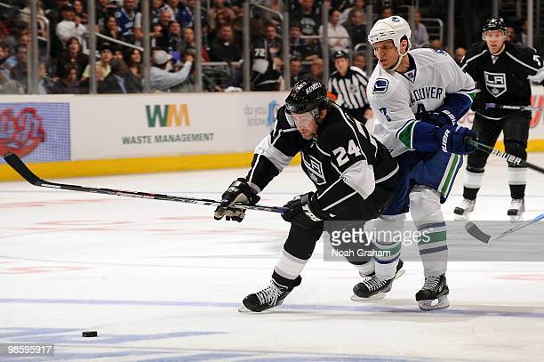 Alexander Frolov of the Los Angeles Kings reaches for the puck against the Vancouver Canucks in Game Three of the Western Conference Quarterfinals...
