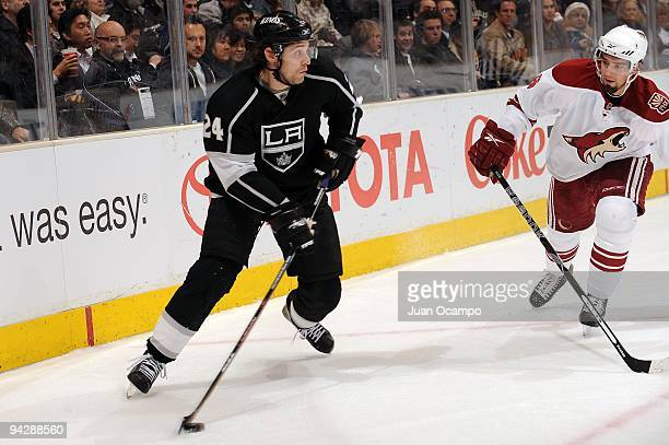 Alexander Frolov of the Los Angeles Kings skates with the puck against David Schlemko of the Phoenix Coyotes on December 10 2009 at Staples Center in...