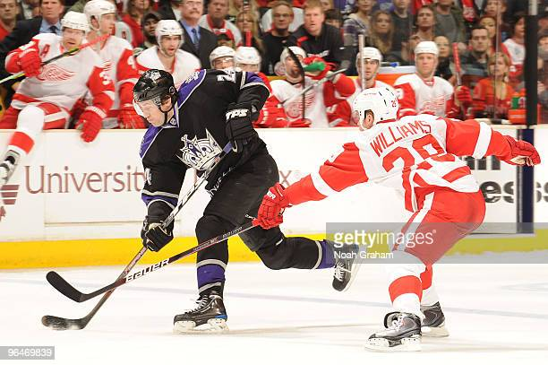 Alexander Frolov of the Los Angeles Kings skates with the puck against Jason Williams of the Detroit Red Wings on February 6 2010 at Staples Center...