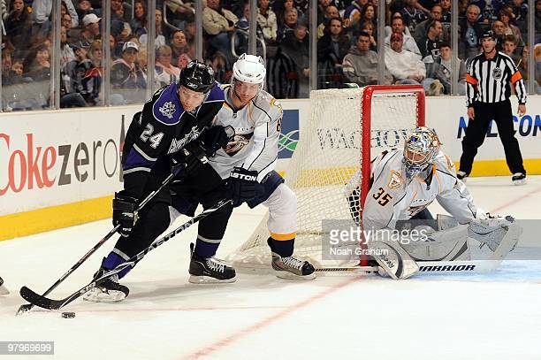 Alexander Frolov of the Los Angeles Kings skates with the puck against Kevin Klein of the Nashville Predators on March 14 2010 at Staples Center in...