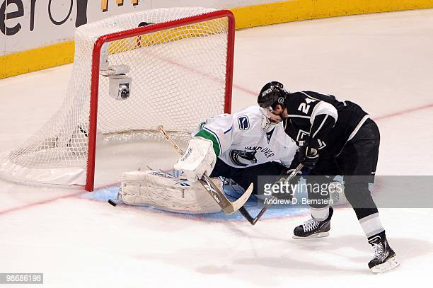 Alexander Frolov of the Los Angeles Kings takes the shot against Roberto Luongo of the Vancouver Canucks in Game Six of the Western Conference...