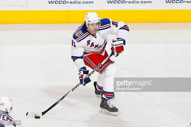Alexander Frolov of the New York Rangers delivers a pass against the Minnesota Wild during the game at the Xcel Energy Center on November 20 2010 in...