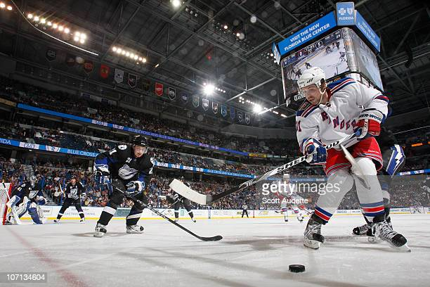 Alexander Frolov of the New York Rangers passes the puck away from the boards against Mattias Ritola of the Tampa Bay Lightning at the St Pete Times...