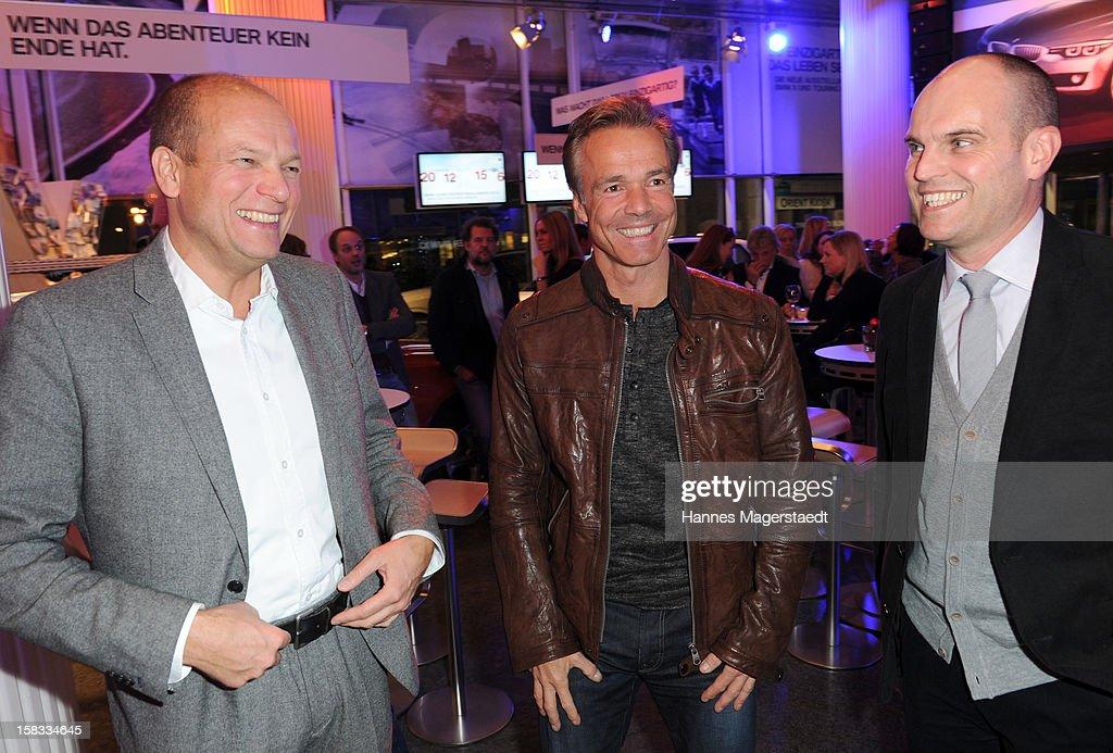 Alexander Gedat, Hannes Jaenicke and Juergen Hahn attend the BMW Adventskalender opening with Hannes Jaenicke at the BMW Pavillion on December 13, 2012 in Munich, Germany.