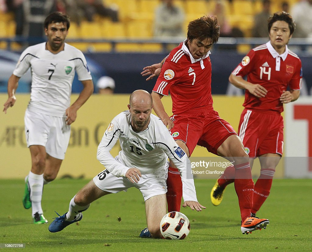 Alexander Geynrikh of Uzbekistan is fouled by <a gi-track='captionPersonalityLinkClicked' href=/galleries/search?phrase=Zhao+Xuri&family=editorial&specificpeople=596391 ng-click='$event.stopPropagation()'>Zhao Xuri</a> of China P.R during the AFC Asian Cup Group A match between China P.R and Uzbekistan at AL Gharafa Stadium on January 16, 2011 in Doha, Qatar.