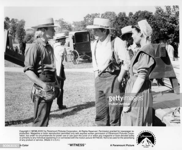 Alexander Godunov gives advice to Harrison Ford and Kelly McGillis in a scene from the Paramount Pictures movie 'Witness' circa 1985