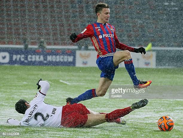 Alexander Golovin of PFC CSKA Moscow challenged by Alexander Milkovich of FC Amkar Perm during the Russian Premier League match between PFC CSKA...