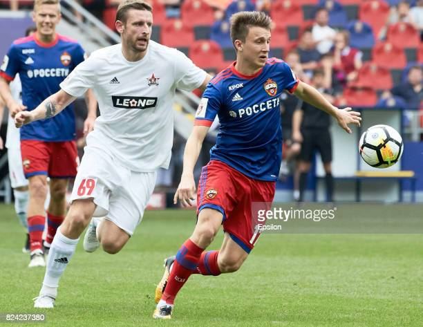 Alexander Golovin of PFC CSKA Moscow vies for the ball with Denys Dedechko of FC SKA Khabsrovsk during the Russian Premier League match between PFC...