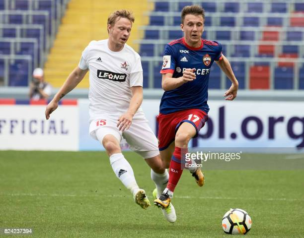 Alexander Golovin of PFC CSKA Moscow vies for the ball with Yevgeni Balyaikin of FC SKA Khabsrovsk during the Russian Premier League match between...