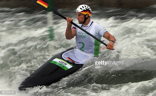 Alexander Grimm of Germany competes in the 2008 Beijing Olympic Games Mens's singles Kayak K1 slalom heats event at the Shunyi Rowing and Canoeing...