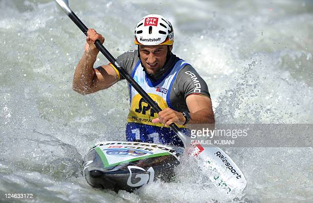Alexander Grimm of Germany competes in the K1 men final race at the ICF Canoe/Kayak Slalom Racing World Championships in Cunovo near Bratislava on...