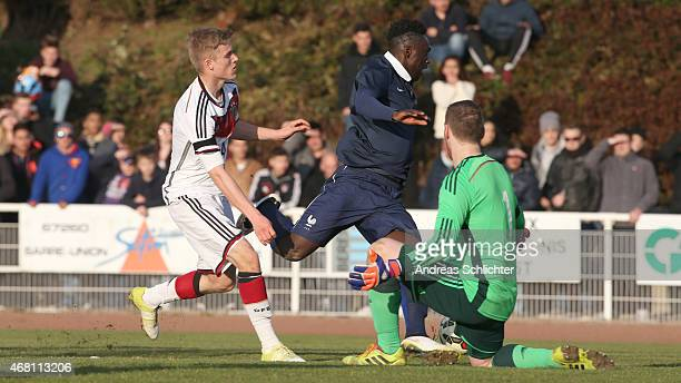 Alexander Gschwend and Keeper Timo Königsmann of germany challenges Jean Kevin Augustin of france during the friendly match between U18 France and...
