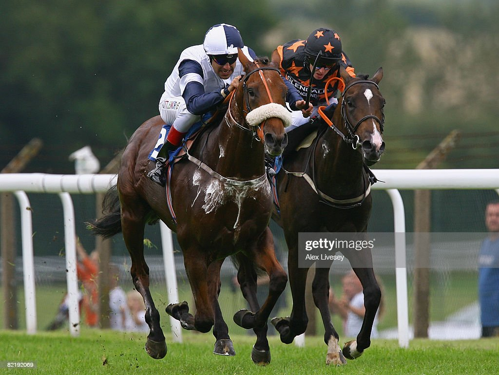 Alexander Gulch ridden by Darryll Holland (L) beats Olympic Dream ridden by Tony Hamilton to win the Ronnie Senior 80th Birthday Maiden Stakes run at Pontefract Racecourse on August 6, 2008 in Pontefract, England.