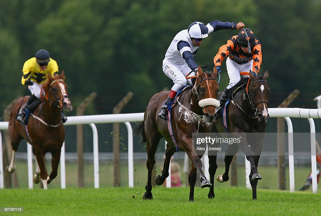 Alexander Gulch ridden by Darryll Holland (c) beats Olympic Dream ridden by Tony Hamilton (r) to win the Ronnie Senior 80th Birthday Maiden Stakes run at Pontefract Racecourse on August 6, 2008 in Pontefract, England.