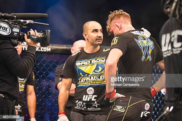 Alexander Gustafsson of Sweden consoled by his coach after his TKO defeat to Anthony Johnson of the United States during the UFC Fight Night event at...