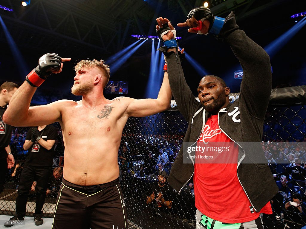 Alexander Gustafsson of Sweden raises opponent Anthony Johnson's hand after Johnson knocked out Gustafsson in their light heavyweight bout during the UFC Fight Night event at the Tele2 Arena on January 24, 2015 in Stockholm, Sweden.