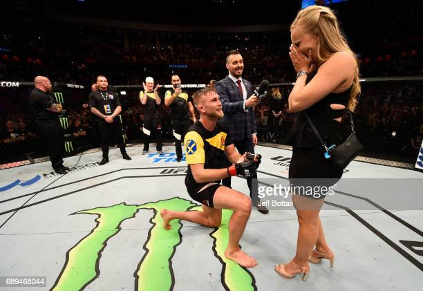 Alexander Gustafsson proposes to his girlfriend Moa Antonia Johansson after his knockout victory over Glover Teixeira in their light heavyweight...