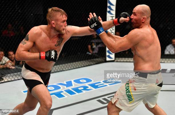 Alexander Gustafsson punches Glover Teixeira in their light heavyweight fight during the UFC Fight Night event at the Ericsson Globe Arena on May 28...