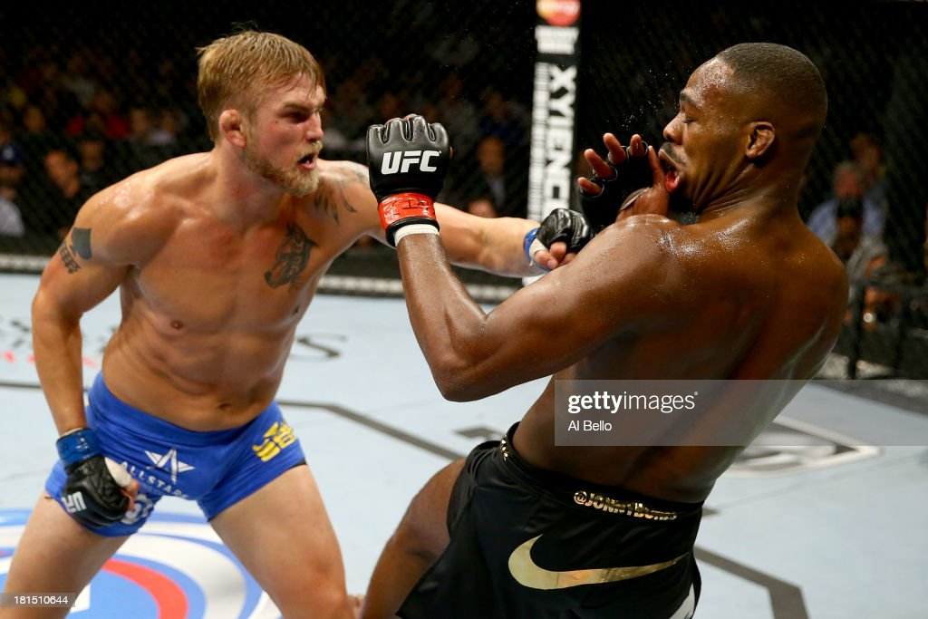 Alexander Gustafsson punches Jon 'Bones' Jones in their UFC light heavyweight championship bout at the Air Canada Center on September 21, 2013 in Toronto, Ontario, Canada.