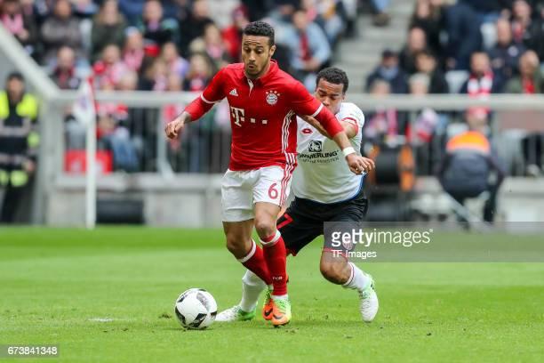 Alexander Hack of Mainz Robin Kwamina Quaison of Mainz and Arturo Erasmo Vidal of Munich battle for the ball during the Bundesliga match between...