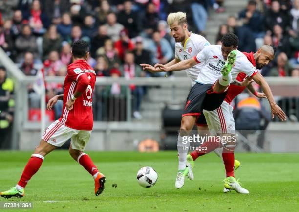 Alexander Hack of Mainz Robin Kwamina Quaison of Mainz and Thiago Alcantara of Munich Arturo Erasmo Vidal of Munich battle for the ball during the...