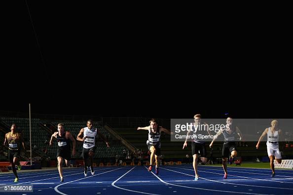 Alexander Hartmann of Queensland leads Jack Hale of Tasmania and Aaron Stubbs of Queensland during the mens 100m final during the Australian...