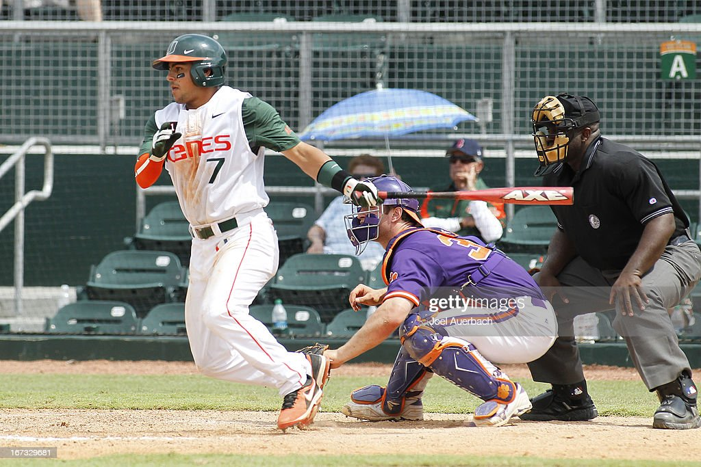 Alexander Hernandez #7 of the Miami Hurricanes hits the ball against the Clemson Tigers on April 21, 2013 at Alex Rodriguez Park at Mark Light Field in Coral Gables, Florida. Miami defeated Clemson 7-0.