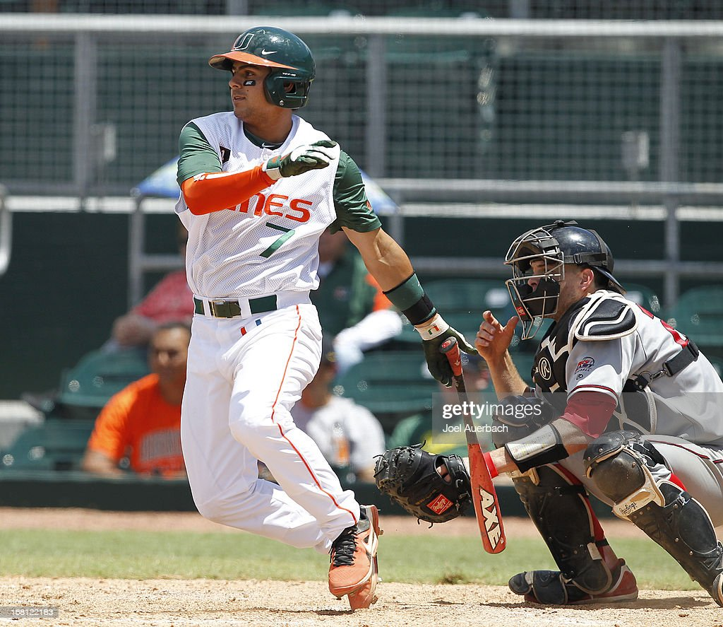Alexander Hernandez #7 of the Miami Hurricanes hits the ball against the St John's Red Storm on May 5, 2013 at Alex Rodriguez Park at Mark Light Field in Coral Gables, Florida. Miami defeated St John's 6-4 and swept the weekend series.