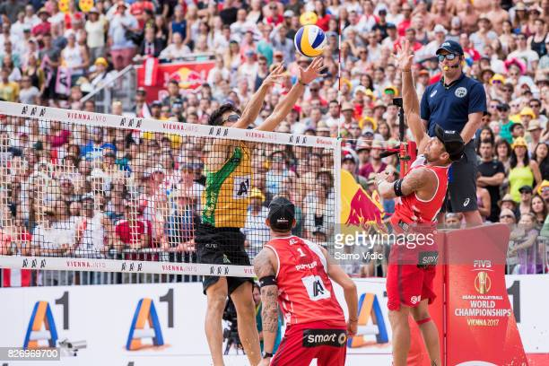 Alexander Horst of Austria spikes the ball during the gold medal match against Andre Loyola Stein and Evandro Goncalves Oliveira Junior of Brazil at...