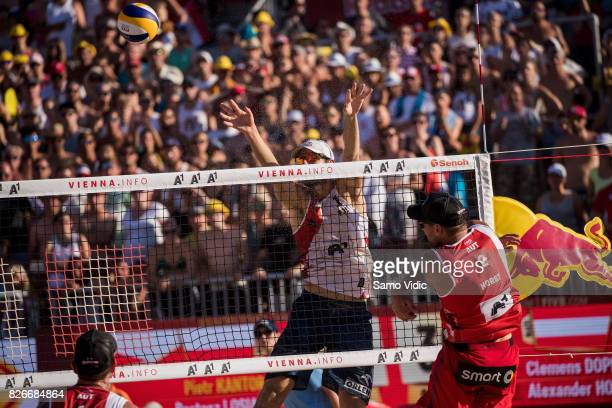 Alexander Horst of Austria spikes the ball during the quarter final match against Bartosz Losiak and Piotr Kantor of Poland at FIVB Beach Volleyball...