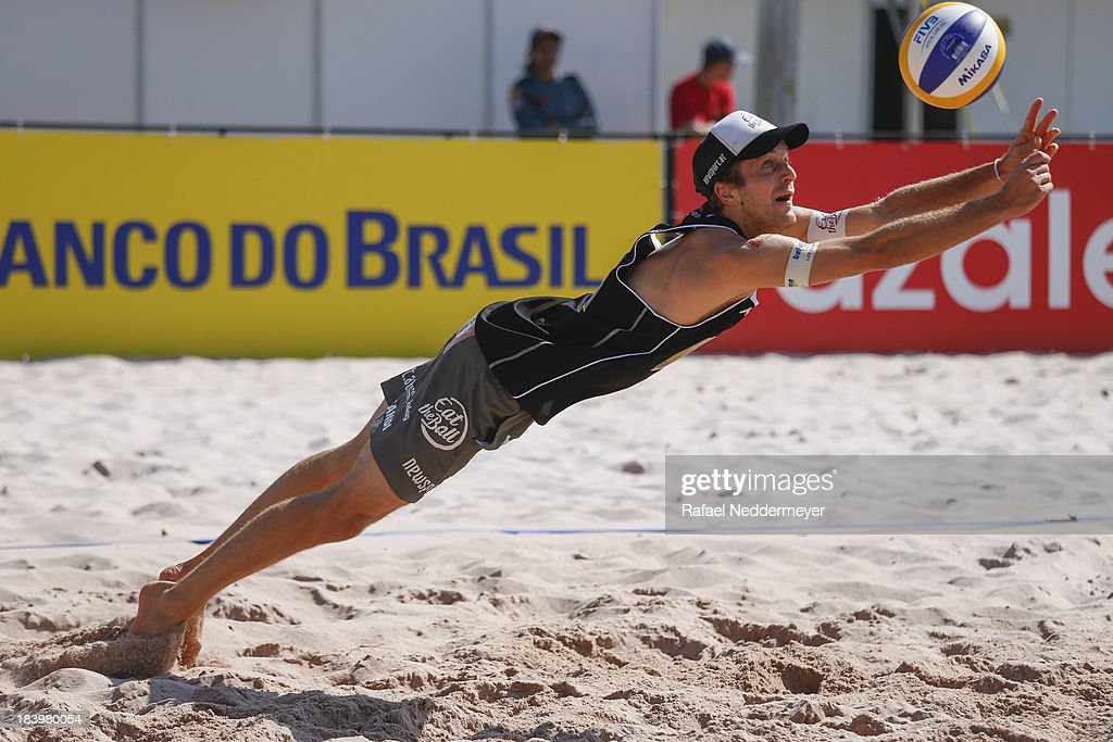 <a gi-track='captionPersonalityLinkClicked' href=/galleries/search?phrase=Alexander+Huber&family=editorial&specificpeople=746872 ng-click='$event.stopPropagation()'>Alexander Huber</a> of Austria in action during day third of the FIVB Beach Volleyball Sao Paulo Grand Slam 2013 at Parque Villa Lobos on October 10, 2013 in Sao Paulo, Brazil.