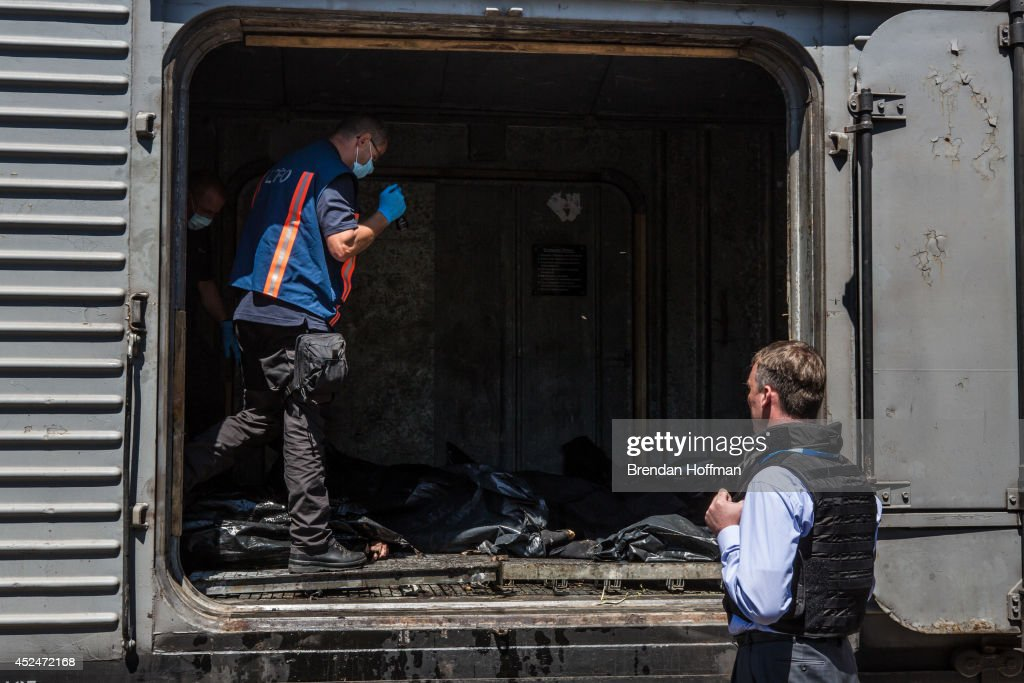 Alexander Hug (R), Deputy Chief Monitor of the Organisation for Security and Cooperation in Europe (OSCE) Special Monitoring Mission to Ukraine, visits a train containing the bodies of victims of the Malaysia Airlines flight MH17 crash on July 21, 2014 in Torez, Ukraine. Together with Dutch inspectors, the storage conditions were declared acceptable, though it is still unclear where or when the train will be moved. Malaysia Airlines flight MH17 was travelling from Amsterdam to Kuala Lumpur when it crashed killing all 298 on board including 80 children. The aircraft was allegedly shot down by a missile and investigations continue over the perpetrators of the attack.