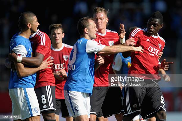 Alexander Iashvili of Bochum holds back Danny da Costa of Ingolstadt who is arguing with Mounir Chaftar of Bochum after the Second Bundesliga match...