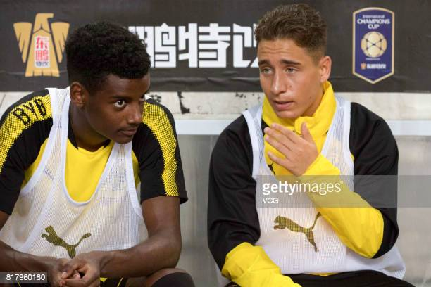 Alexander Isak and Emre Mor of Borussia Dortmund chat on the bench during the 2017 International Champions Cup China between AC Milan and Borussia...
