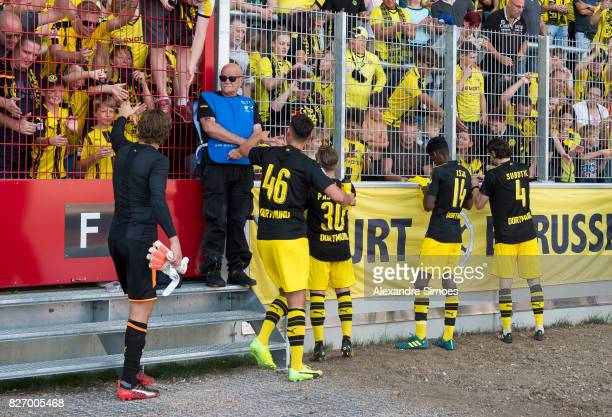Alexander Isak Neven Subotic JanniLuca Serra and Felix Passlack of Borussia Dortmund together with the fans after the final whistle during the...
