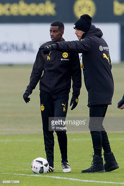 Alexander Isak of Borussia Dortmund and Head couch Thomas Tuchel of Borussia Dortmund gestures during a training session at the BVB Training center...