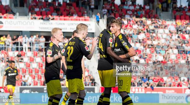 Alexander Isak of Borussia Dortmund celebrates after scoring a goal to make it 24 together with Maximilian Philipp during the preseason friendly...