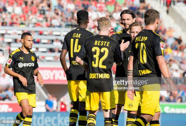 Alexander Isak of Borussia Dortmund celebrates after scoring a goal to make it 23 together with Neven Subotic during the preseason friendly match...