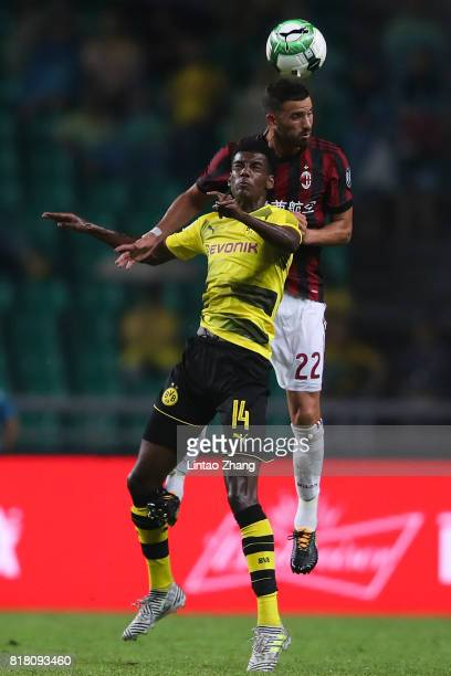 Alexander Isak of Borussia Dortmund competes for the ball with Mateo Musacchio of AC Milan during the 2017 International Champions Cup football match...