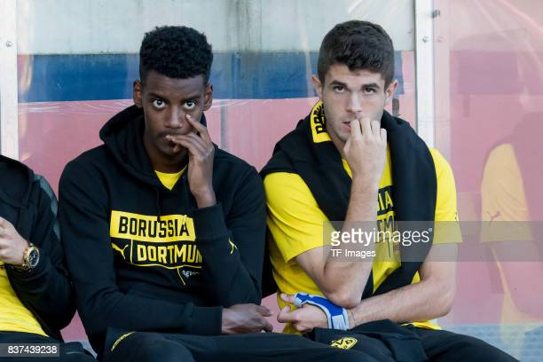 Alexander Isak of Dortmund and Christian Pulisic of Dortmund sits on the bench during a friendly match between Espanyol Barcelona and Borussia...