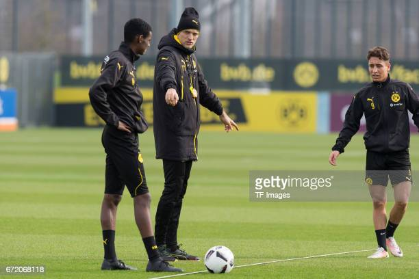 Alexander Isak of Dortmund Head coach Thomas Tuchel of Dortmund and Emre Mor of Dortmund looks on during a training session at the BVB Training...