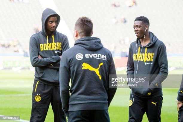 Alexander Isak Ousmane Dembele and Raphael Guerreiro of Borussia Dortmund prior to the Bundesliga match between Hertha BSC and Borussia Dortmund at...