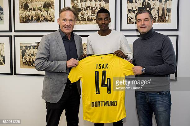 Alexander Isak signs a new contract with Borussia Dortmund with HansJoachim Watzke and Michael Zorc on January 23 2017 in Dortmund Germany