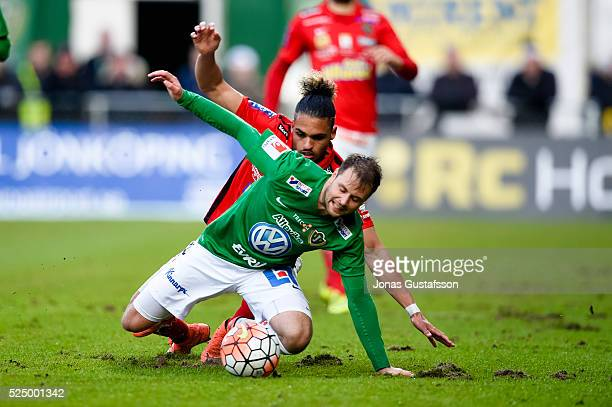 Alexander Jakobsen of Falkenberg and Tom Siwe of Jonkopings Sodra competes for the ball during the allsvenskan match between Jonkopings Sodra IF and...