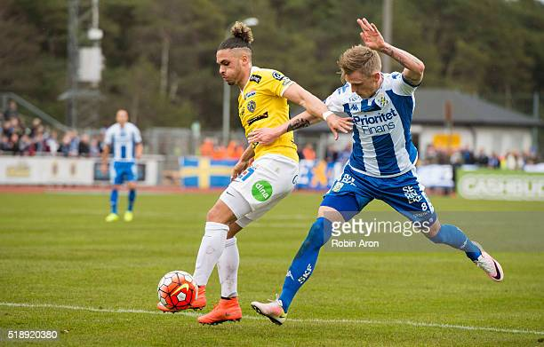 Alexander Jakobsen of Falkenberg FF holds the ball away from Soren Rieks of IFK Goteborg during the Allsvenskan match between Falkenbergs FF and IFK...