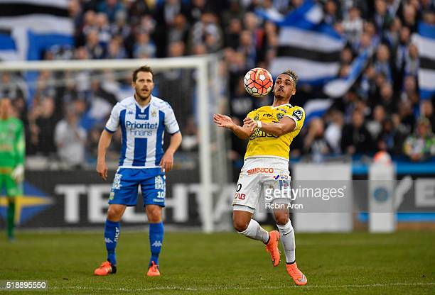 Alexander Jakobsen of Falkenberg FF with the ball Tobias Hysen of IFK Goteborg in the background during the Allsvenskan match between Falkenbergs FF...