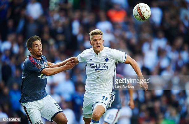 Alexander Juel Andersen of AGF Aarhus and Andreas Cornelius of FC Copenhagen compete for the ball during the Danish Alka Superliga match between FC...
